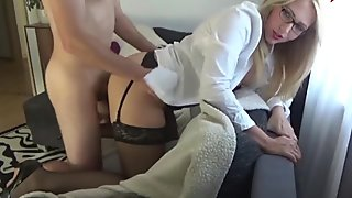 horny blonde in stockings on the couch