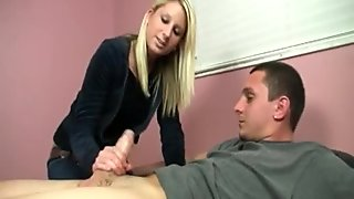 Blondie strokes cock on her bed