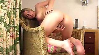 Blonde girl mastrubate on the settee